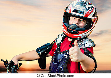 Handicapped quad bike rider doing thumbs up.