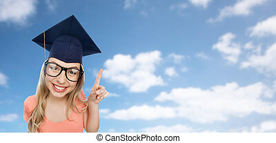 smiling young student woman in mortarboard - people,...