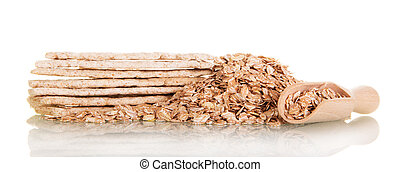 Rolled oats in wooden spoon and cookies isolated on white. -...