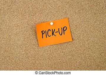 Pick-Up written on orange paper note pinned on cork board...