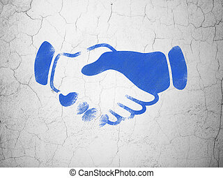 Business concept: Handshake on wall background
