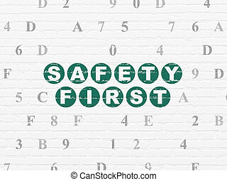 Safety concept: Safety First on wall background - Safety...