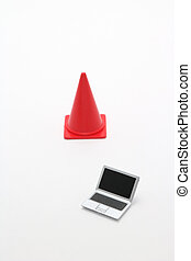 Laptop and safety cone.