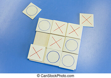 Homemade educational wooden tic-tac-toe game