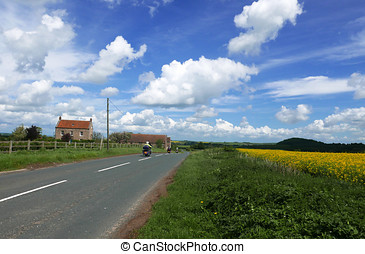 Motorcycle riders on country road. - Motorcyclists ride down...