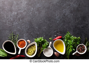 Herbs, condiments and spices on stone background. Top view...