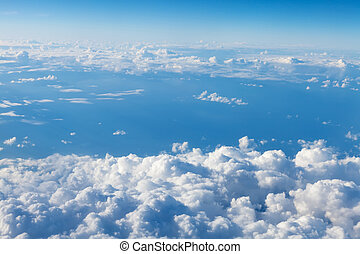 Blue sky with clouds. View from airplane