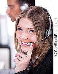 Business woman speaking through head phone
