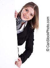 Happy young women peeking through a blank board