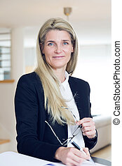 Business woman working from home - Attractive blonde...