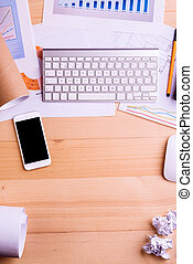 Gadgets and office supplies. Studio shot, wooden background.