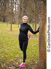 woman stretching in park
