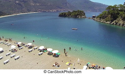 Blue Lagoon and Oludeniz Beach - Flying over the beach at...