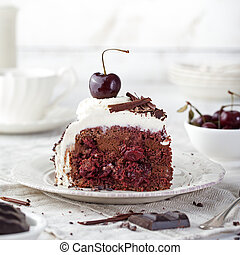 Black forest cake ,decorated with whipped cream and cherries...
