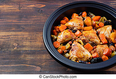 Tagine with cooked chicken and vegetables. Traditional...