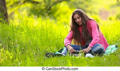 girl sitting and that the said - girl sits in nature and...