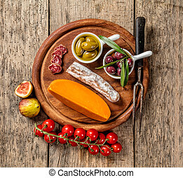 Various kind of cheese and delicacy on wood - Various kind...