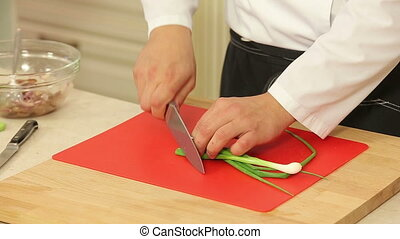 Green onions chopping - Chef is chopping green onions