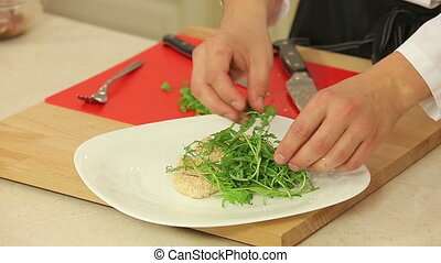 Roasted chicken fillet with salad - Chef is serving roasted...