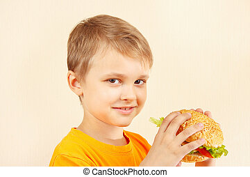 Little cut boy with tasty sandwich - Little cut boy with a...