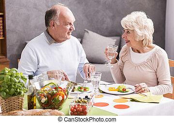 Do you like the salad? - Shot of a happy elderly couple...