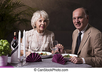 Romantic dinner for a special occasion - Shot of an elderly...
