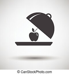 Apple inside cloche icon on gray background with round...