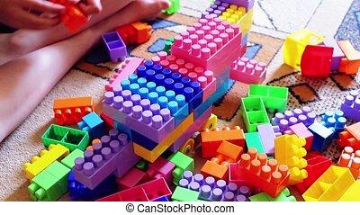 Kids building spaceship with plastic blocks - Kids building...