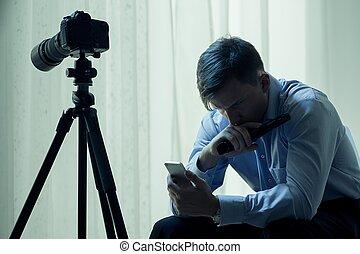 My work is top secret - Man sitting in dark interior next to...