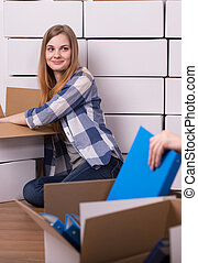 Moving out is exciting - Shot of a young woman sitting on a...