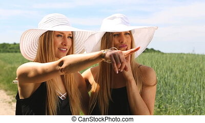 female twins making a bicycle tour. summerfeeling. hd -...