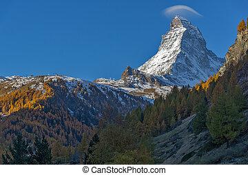 Matterhorn peak, view from Zermatt - First Rays of Sun over...