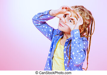 lively child - Pretty modern little girl with braids over...