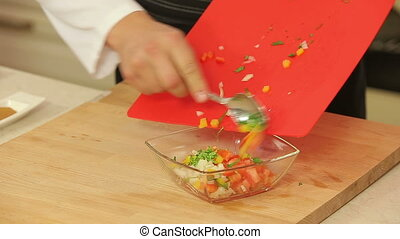 Fresh salsa vegetables - Chef is seasoning a bowl of fresh...
