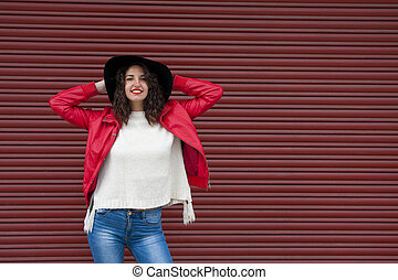 urban fashion girl on red background