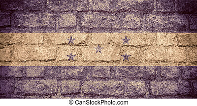 flag of Honduras or Honduran banner on brick texture