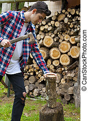 young guy with firewood