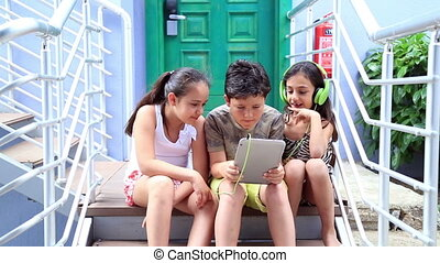 Kids with digital tablet - Close up portrait of three...