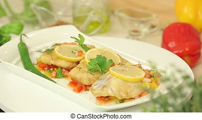 Baked fish with salsa vegetables - Presentation of baked...