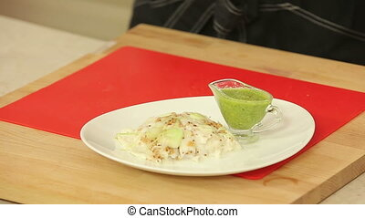 Serving baked fish fillet - Chef is serving baked fish...