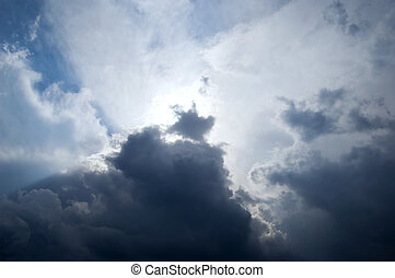 thunderclouds - The sun breaks through storm clouds