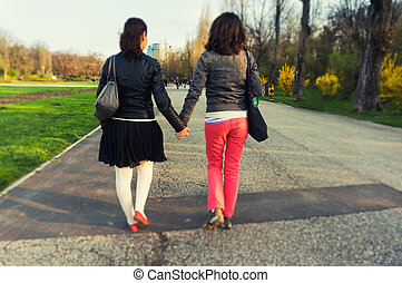 Woman walking holding hands