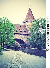 Old tower in Nuremberg - Old tower and bridge in Nuremberg,...