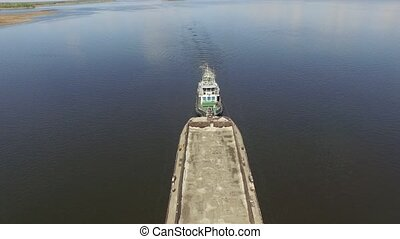 Long barge floating on the Dnieper river. Aerial view. Top...