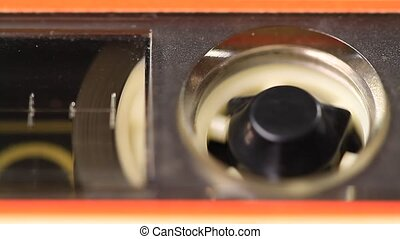 Cassette tape playing in the mind - Macro static camera view...