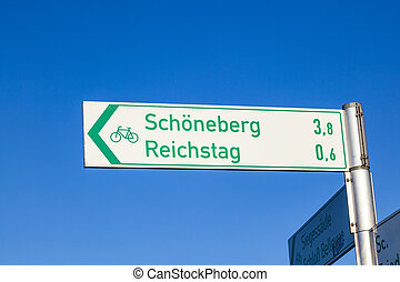 sign for tourists direction reichstag and Schoenefeld in...