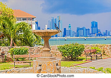 Old fountain in Cosco Viejo, Panama city and the skyscrapes...