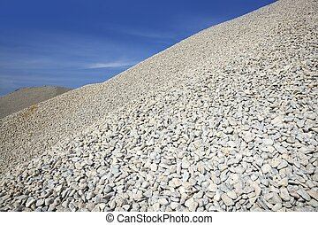 gravel gray mound quarry stock blue sky rolling stones