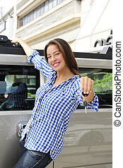 rich woman showing keys of her new bulletproof car - new...