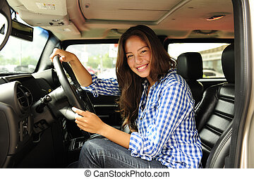 woman driving her new bulletproof truck - new car: woman...